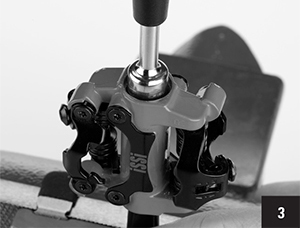 Step 3: Remove spindle lock nut using a thin-wall 9mm socket. The right spindle lock nut uses a left-hand thread while the left spindle lock nut uses a right- hand thread.